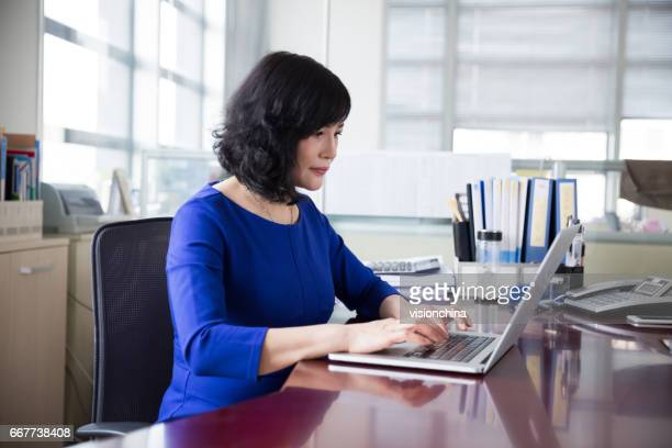 middle-aged female manager working in office