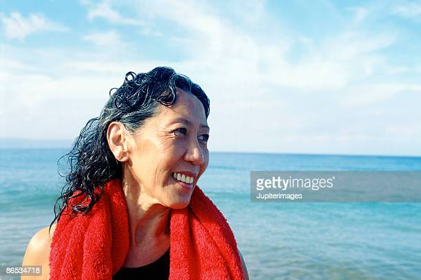 middle-aged female swimmer - 50 59 years stock pictures, royalty-free photos & images