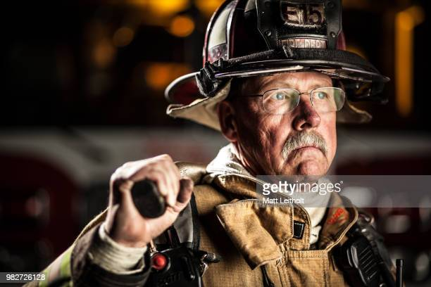 a middle-aged fire-fighter. - images stock pictures, royalty-free photos & images