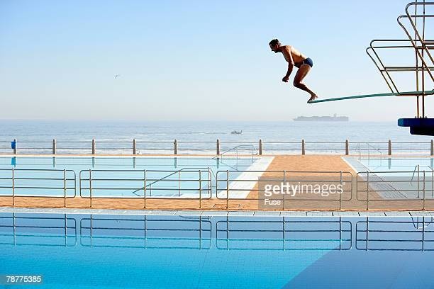 Middle-Aged Man Diving from the Highdive