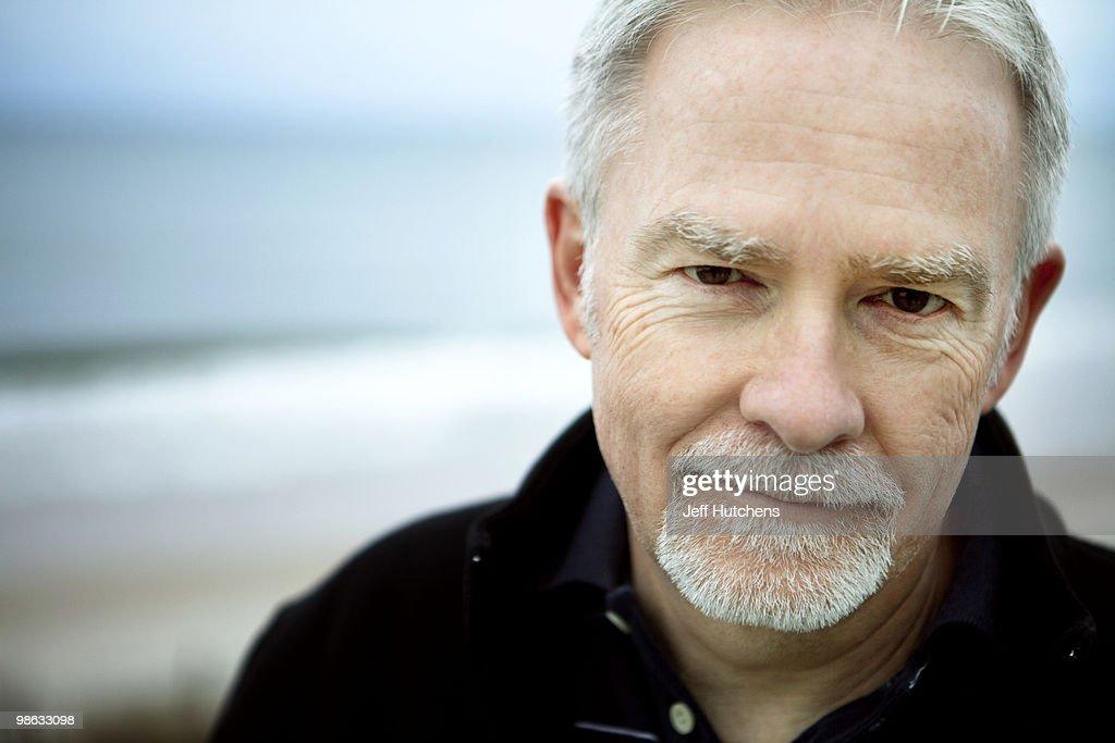 A middle-aged man enjoys the North Carolina beach. : Stock Photo