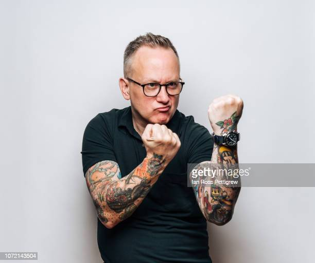 middle-aged man hands up ready to fight - fighting stance stock pictures, royalty-free photos & images