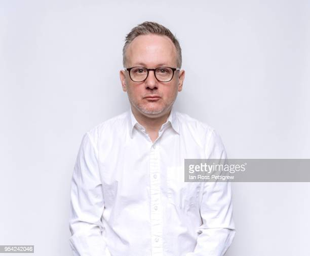 middle-aged man in white dress shirt - シャツ ストックフォトと画像