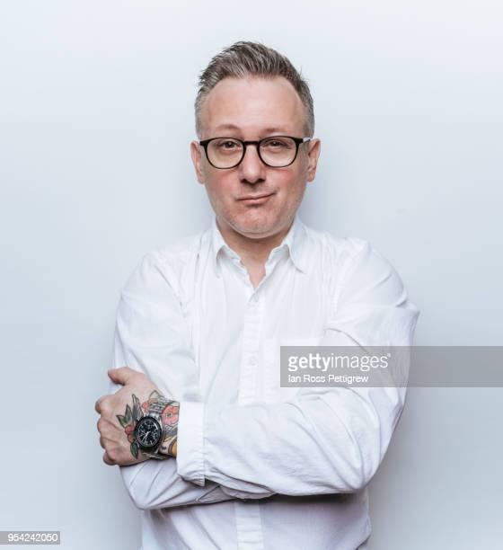 middle-aged man in white dress shirt - wit hemd stockfoto's en -beelden