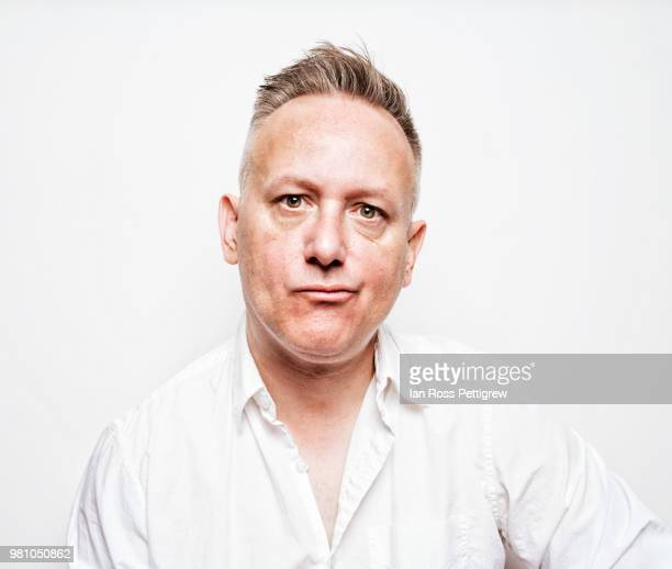 middle-aged man in white shirt on white background - reizen stock-fotos und bilder