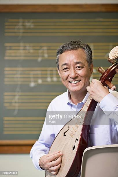 Middle-Aged Man Learning the Pipa