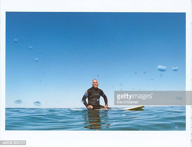 Middle-aged Man on Surfboard