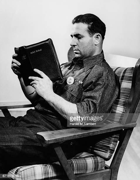 middle-aged man reading bible - number of people stock pictures, royalty-free photos & images