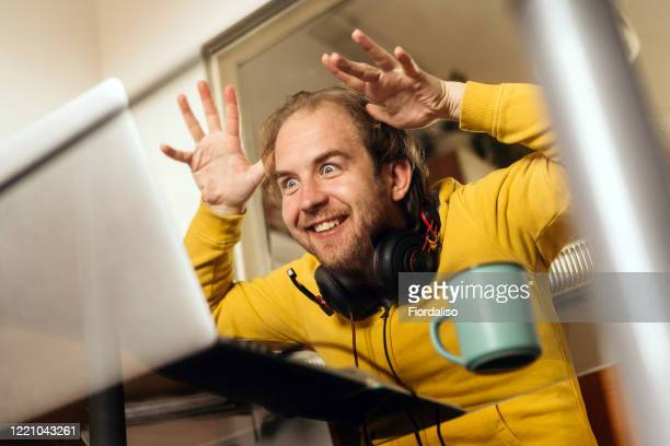 a middle-aged man sitting in the kitchen at the glass table - thick stock pictures, royalty-free photos & images