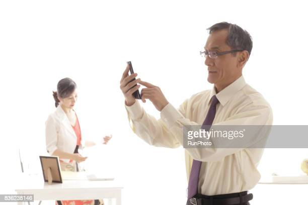Middle-aged man who is operating a smartphone