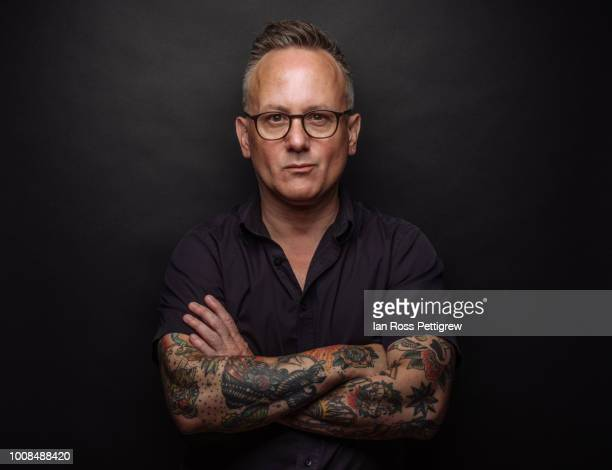 middle-aged man with tattoos - tattoo stock pictures, royalty-free photos & images