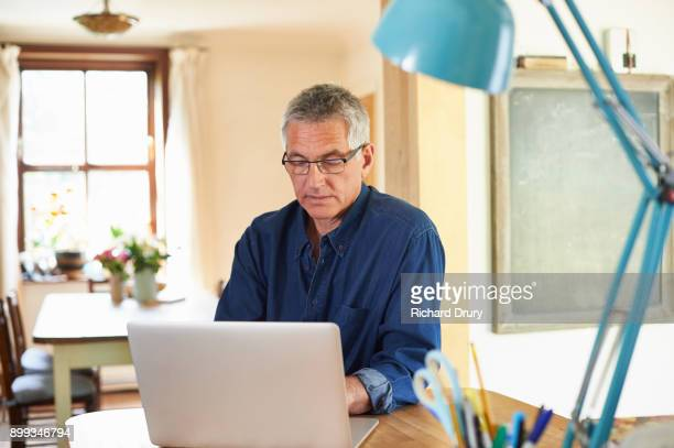 Middle-aged man working from home