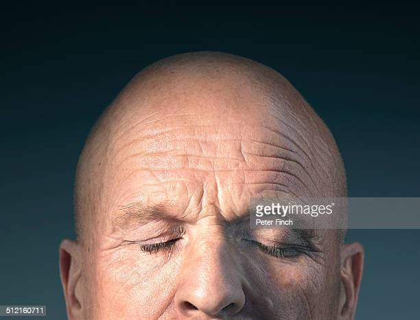 middle-aged man's face with eyes closed - completely bald stock pictures, royalty-free photos & images
