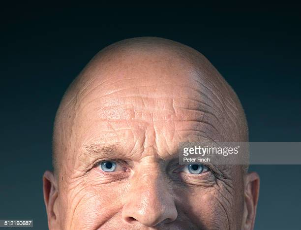middle-aged man's face with eyes open - completamente calvo foto e immagini stock
