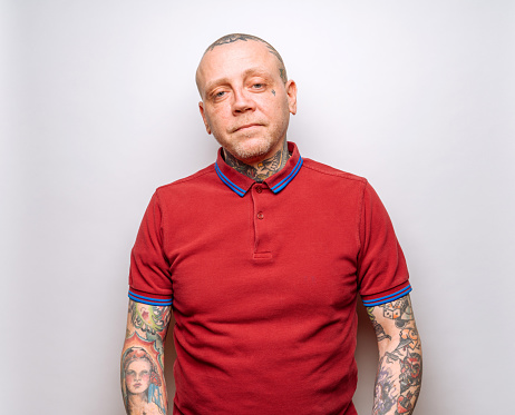 Middle-aged Punk Rocker with Tattoos - gettyimageskorea
