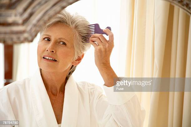 Middle-Aged Woman Combing Hair