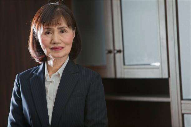 a middle-aged woman in a suit - serious professional old female asian stock pictures, royalty-free photos & images