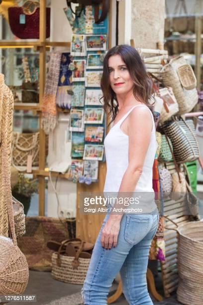 middle-aged woman in a touristic street in valencia, spain - sergi albir fotografías e imágenes de stock