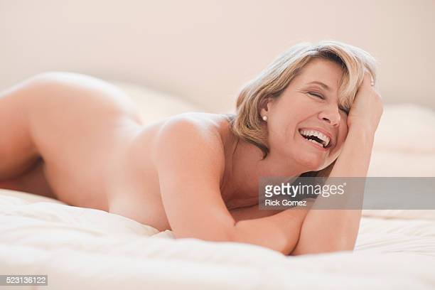 Middle-aged woman lying in bed