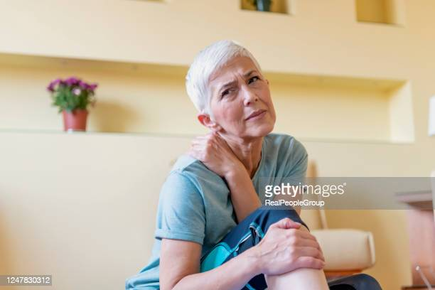 middle-aged woman suffering from pain in leg at home, closeup. physical injury concept. - muscular build stock pictures, royalty-free photos & images