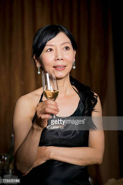 middle-aged woman with wine glass - leren stock pictures, royalty-free photos & images
