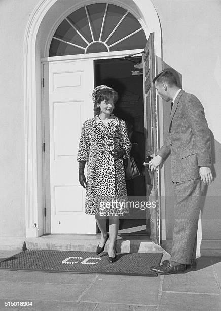 President and Mrs Kennedy shown as they emerge from the Middleburg Community Center where they attended Mass The President is expected to return to...
