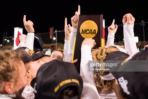 Middlebury College celebrates with the national championship trophy during the Division III Women's Field Hockey Championship held at Trager Stadium...