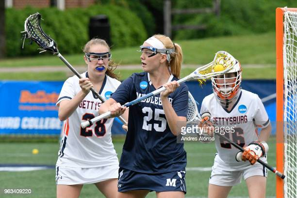 Middlebury College Panthers Kirsten Murphy gets defended at the goal by Gettysburg College Bullets Brooke Holechek and goalie Gettysburg College...