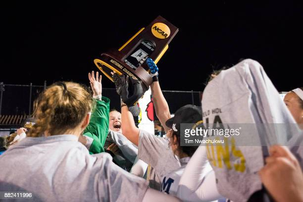 Middlebury College players celebrate with the national championship trophy during the Division III Women's Field Hockey Championship held at Trager...