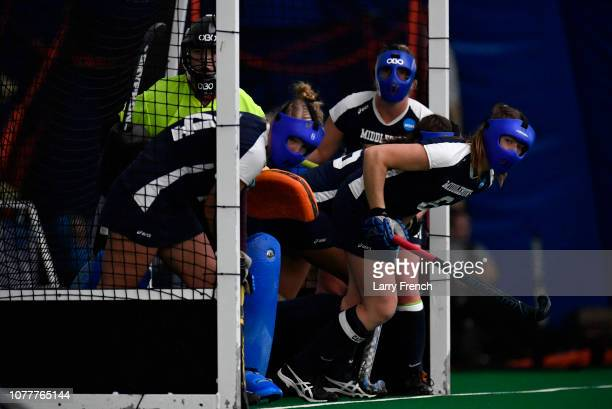 Middlebury Panthers defenders prepare for a penalty corner from the Tufts Jumbos during the Division III Women's Field Hockey Championship held at...