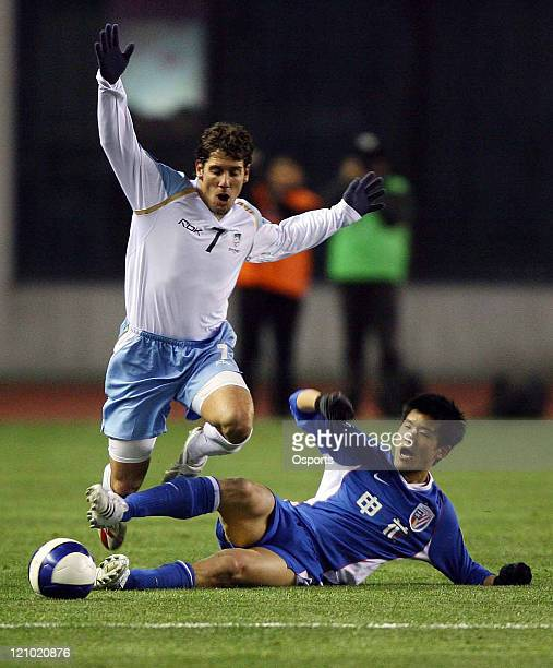 Middleby Robert of Sydney FC is tackled during the AFC Champions League 2007 match between the Sydney FC of Australia and Shanghai Shenhua of China...