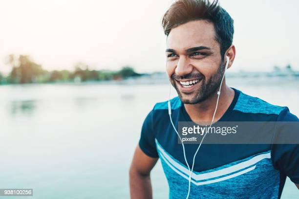 middle-eastern ethnicity sportsman - mp3 player stock pictures, royalty-free photos & images