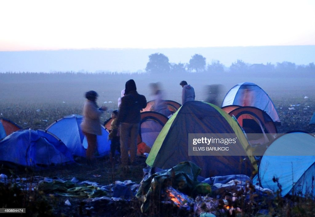 Middle-Eastern migrants are pictured among small tents after spending the night on the ground in a ...  sc 1 st  Getty Images & Eastern migrants are pictured among small tents after spending the ...