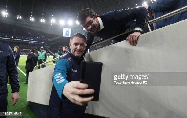 Middlesborough assistant manager Robbie Keane takes a selfie with a fan during the FA Cup Third Round Replay match between Tottenham Hotspur and...
