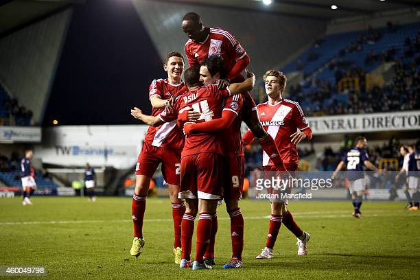 Middlesbrough celebrate with Kike after he scores to make it 51 during the Sky Bet Championship match between Millwall and Middlesbrough at The Den...