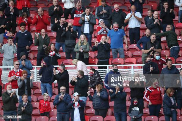 Middlesbrough fans celebrate the first goal from the socially distanced stand during the Sky Bet Championship match between Middlesbrough and AFC...