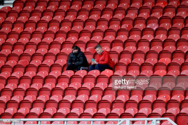 Middlesbrough fans surrounded by empty red seats during the Budwieser FA Cup Third round match between Middlesbrough and Hull City at Riverside...