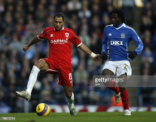 Middlesbrough footballer Mohamed Shawky keeps the ball from Portsmouth footballer Benjani during their Premiership match at Fratton Park in...