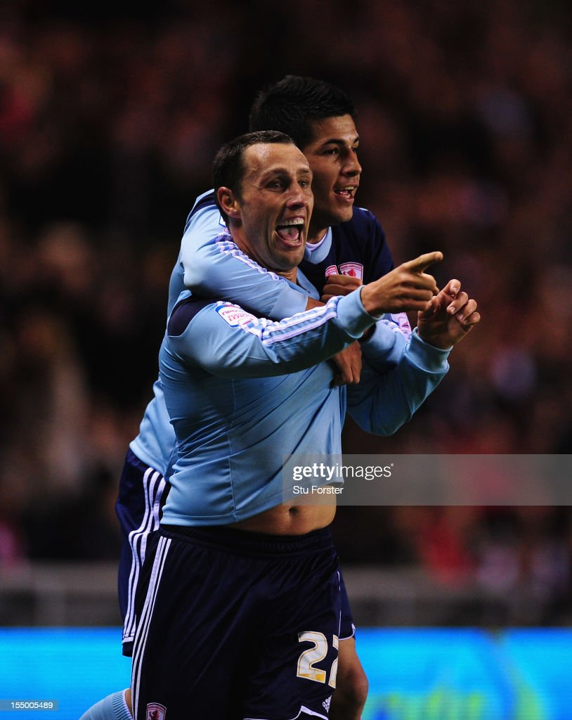 Middlesbrough forward Scott Mcdonald (front) celebrates his opening goal with Emmanuel Ledesma during the Capital One Cup Fourth Round match between Sunderland and Middlesbrough at Stadium of Light on October 30, 2012 in Sunderland, England.