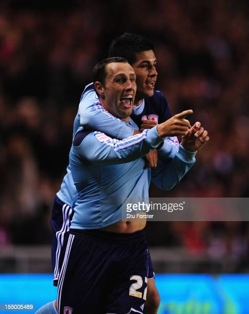 Middlesbrough forward Scott Mcdonald celebrates his opening goal with Emmanuel Ledesma during the Capital One Cup Fourth Round match between...