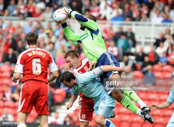 Middlesbrough goalkeeper Carl Ikeme makes a save from the head of Coventry City's Roy O'Donovan during the npower Football League Championship match...