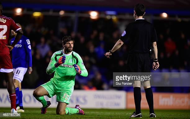 Middlesbrough goalkeeper Dimitrios Konstantopoulos reacts as referee David Coote brandishes the red card for a foul on Clayton Donaldson during the...