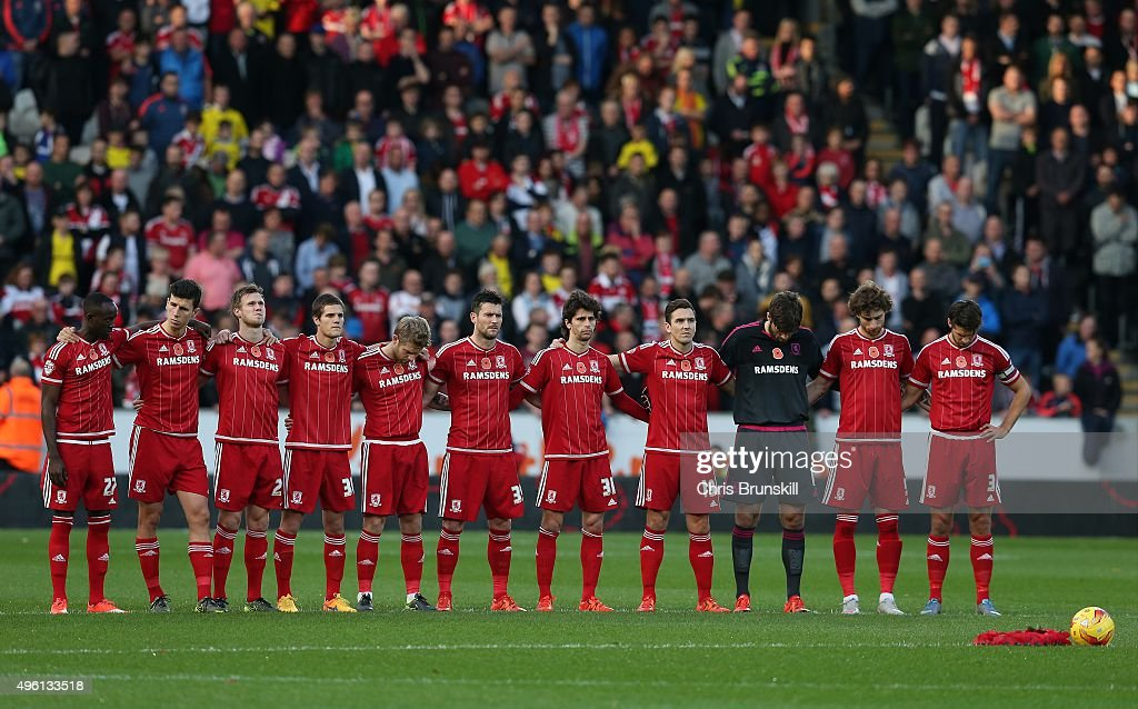 Middlesbrough line up for a minute's silence ahead of Remembrance Sunday before the Sky Bet Championship match between Hull City and Middlesbrough at the KC Stadium on November 7, 2015 in Hull, England.