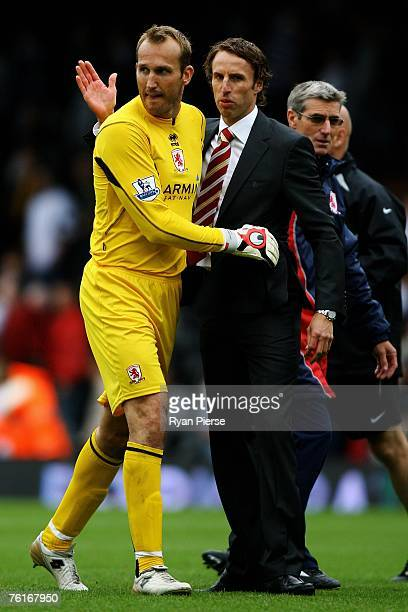 Middlesbrough Manager Gareth Southgate and Mark Schwarzer celebrate after the final whistle during the Barclays Premiership match between Fulham and...