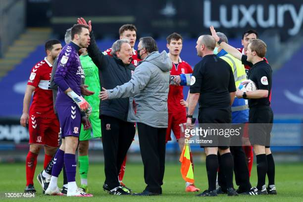 Middlesbrough manager Neil Warnock argues with referee Gavin Ward and the match officials after the Sky Bet Championship match between Swansea City...