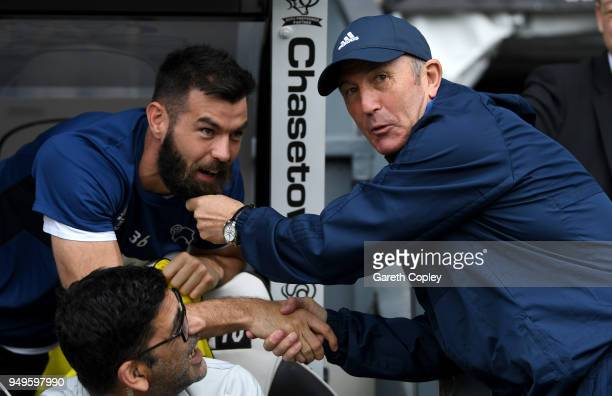 Middlesbrough manager Tony Pulis pulls Joe Ledley of Derby County's beard the Sky Bet Championship match between Derby and Middlesbrough at iPro...