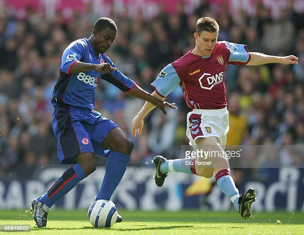 Middlesbrough midfielder George Boateng holds off a challenge from James Milner of Aston Villa during the Barclays Premiership match between Aston...
