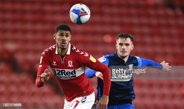Middlesbrough player Ashley Fletcher is challenged by Liam Lindsay of PNE during the Sky Bet Championship match between Middlesbrough and Preston...