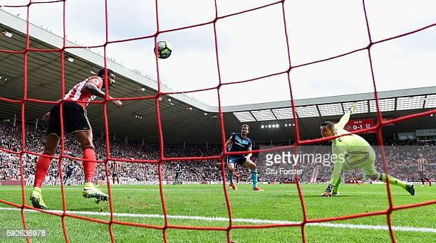 Middlesbrough player Christian Stuani scores the second goal despite the efforts of Sunderland defender Patrick van Aanholt on the line during the...