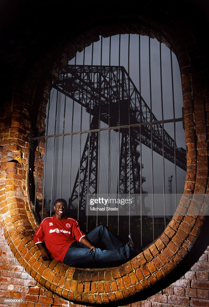 Middlesbrough player George Boateng pictured infront of the Tees Transporter Bridge during a feature shoot on August 22, 2002 in Middlesbrough, England.